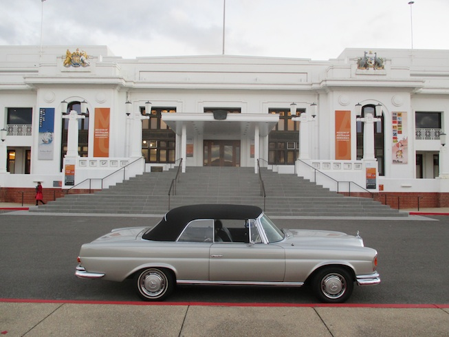1965 Mercedes 250SE Cabriolet in front of old Parliament house.